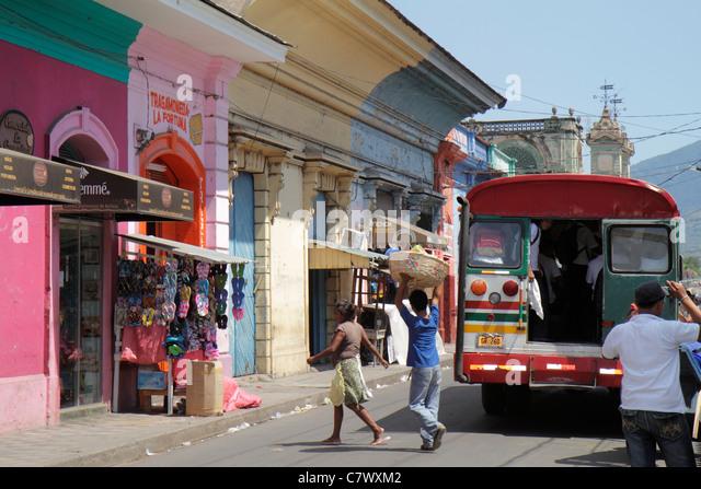 Nicaragua Granada Calle Atravesada colonial heritage neighborhood street scene building business shopping market - Stock Image