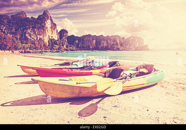 Retro toned kayaks on a tropical beach. Active holidays background. - Stock-Bilder