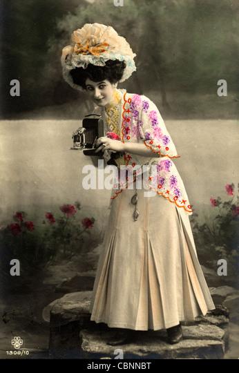 Woman Photographer Holding Vintage Folding Camera - Stock Image