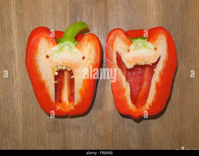Directly Above Shot Of Halved Red Bell Pepper - Stock Image
