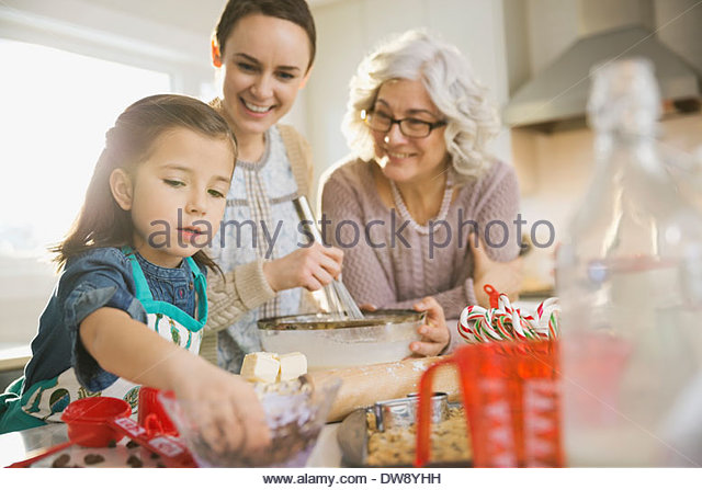 Three generation family baking together during Christmas - Stock Image