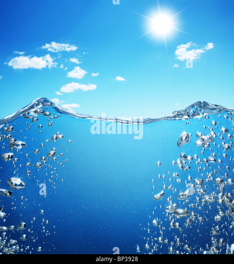 Air bubbles rise from the bottom of the ocean to the surface. - Stock Image