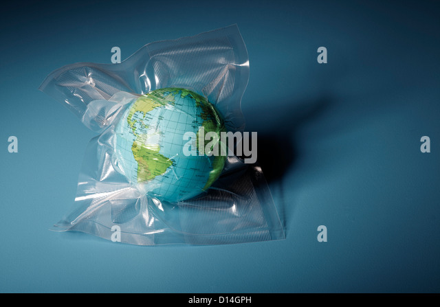 Globe shrink wrapped in plastic - Stock Image