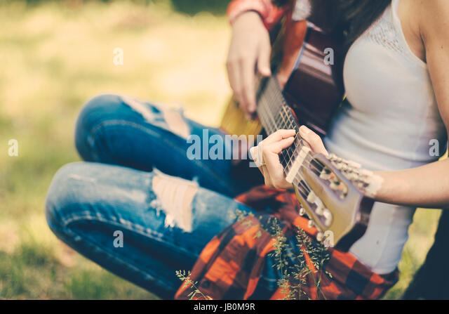 Festival woman with guitar at party - Stock Image