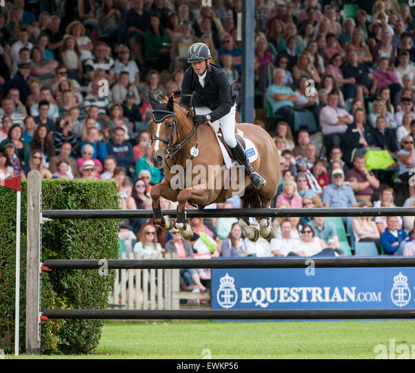Hickstead, UK. 25th June, 2015. Trevor BREEN [IRL] riding LOUGHNATOUSA W B during the Equestrian.Com Derby.  Been - Stock Image