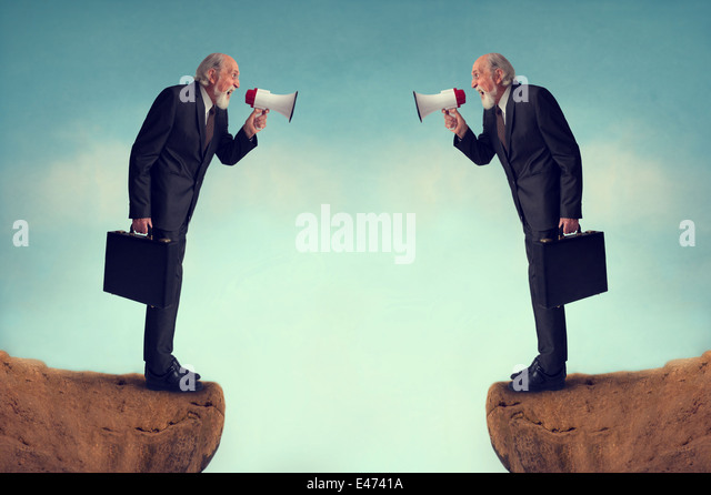 senior businessmen shouting through megaphones business conflict concept - Stock-Bilder