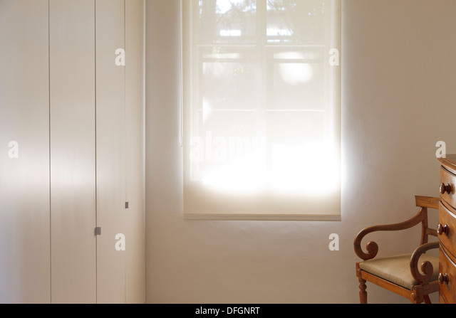 Shade pulled down over window - Stock Image