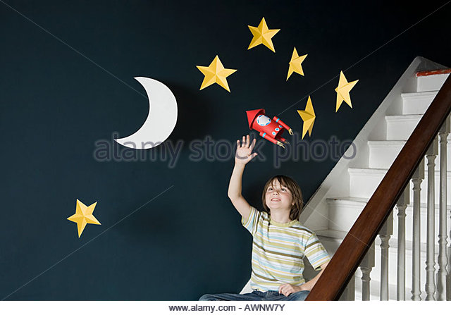 A boy waving at a space - Stock Image