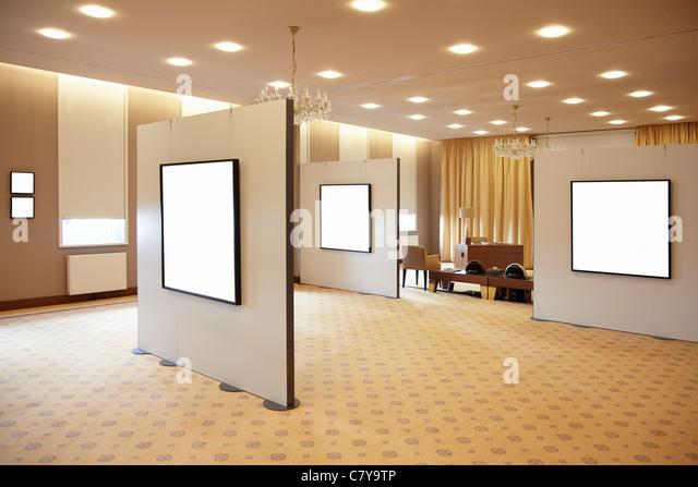 Blank white frames in art gallery interior - Stock-Bilder