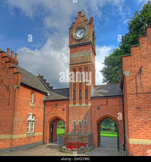Clocktower at Walsall town Arboretum park pond , West Midlands England , UK - Stock Image