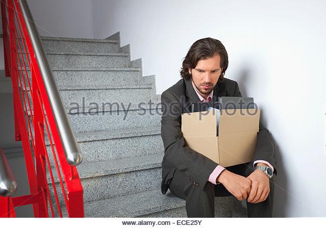 Sad depressed jobless unemployed man alone - Stock Image