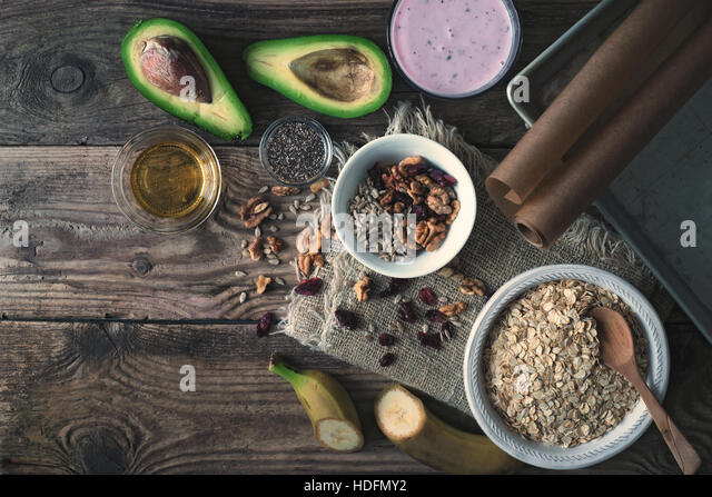 Ingredients for granola on the wooden table - Stock Image