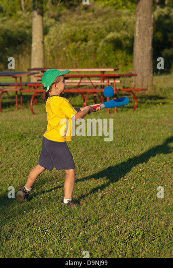 a-young-blond-boy-playing-baseball-in-a-