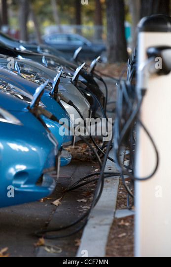 All electric Nissan Leaf cars charging. - Stock Image