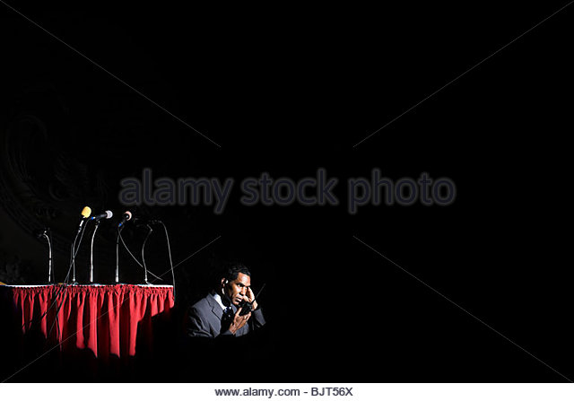 A security guard listening to his walkie talkie - Stock Image