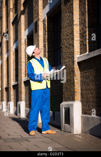 MODEL RELEASED Construction worker wearing a hard hat and a high visibility jacket - Stock Image