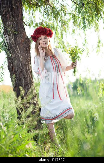 emotional girl in traditional ukrainian costume - Stock Image