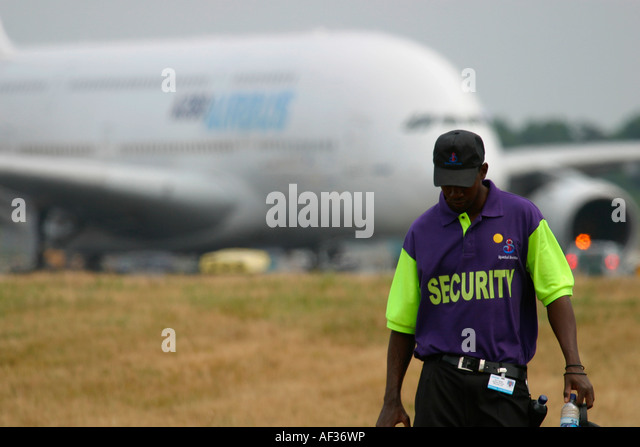 Security guard at Farnborough International Airshow 2006 and Airbus A380 in the background - Stock Image