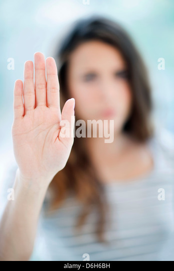 Woman making stop sign - Stock Image