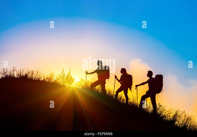 People meeting sunrise team building session - Stock Image
