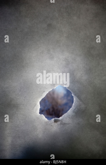 Hole on snow wall - Stock Image
