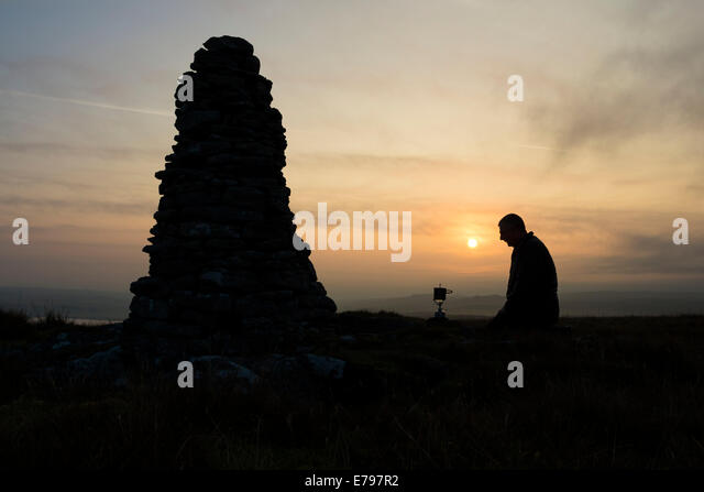 Baldersdale, County Durham UK. 10th September 2014.   UK Weather.  Hiker watching his stove boil water for breakfast - Stock Image