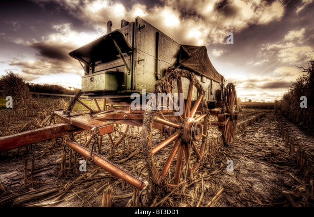1890's farm equipment outdoors in field with summer sky - Stock Image
