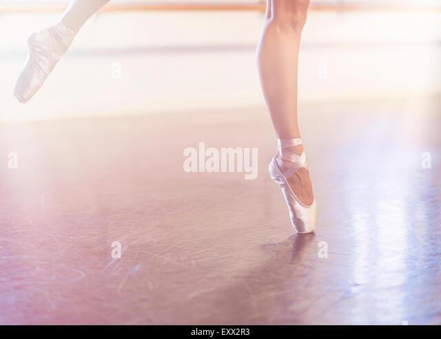Young woman dancing in dance studio - Stock Image