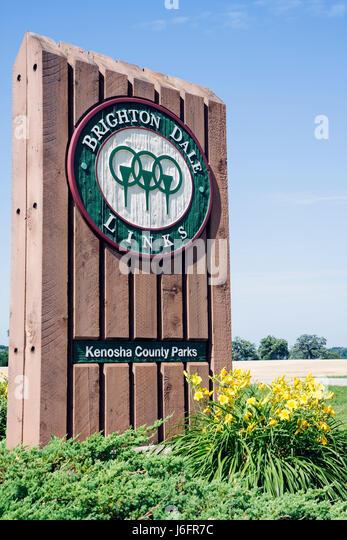 Wisconsin Kenosha Kansasville Brighton Dale Links golf course county park system entrance wood sign logo flowers - Stock Image
