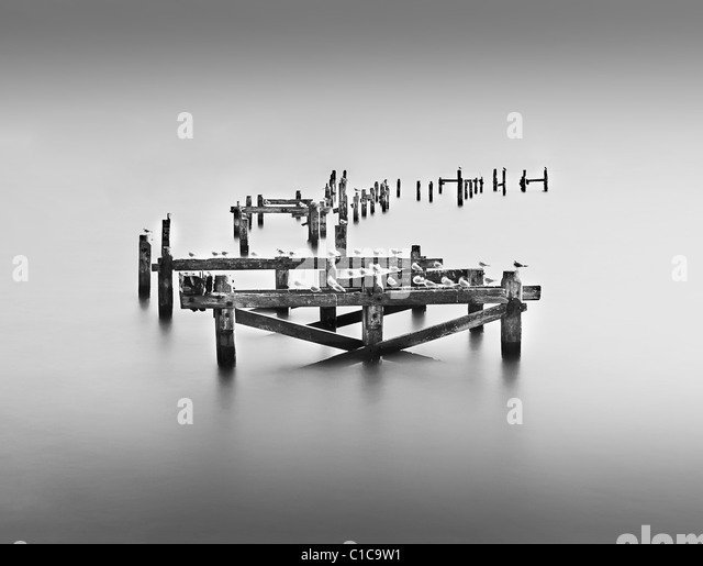 10 Stop Neutral Density Long Exposure Photograph Of Swanage's broken pier - Stock Image