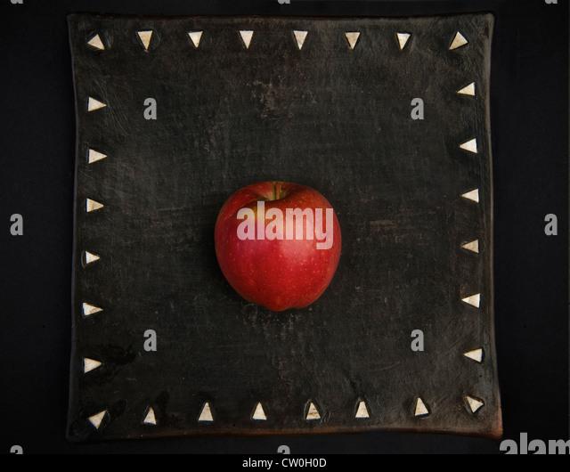 Apple on decorative board - Stock Image