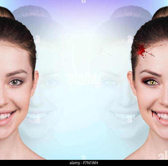Woman with vampire fangs - Stock Image