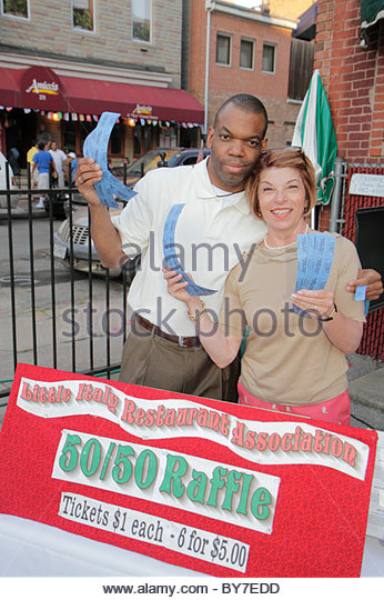 Baltimore Maryland Little Italy ethnic neighborhood working class community event crowd free outdoor movie Black - Stock Image