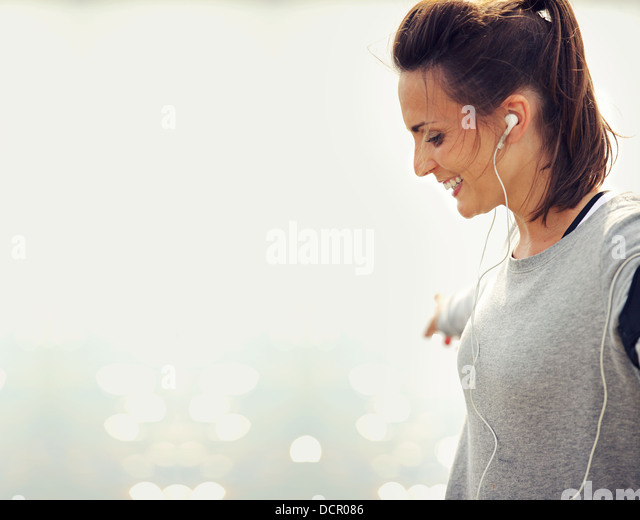 Closeup of a female runner smiling - Stock Image