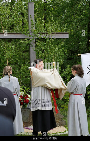 priest serving mass during Whitsun procession, Neuenkleusheim, Olpe, Sauerland, North Rhine-Westfalia, Germany - Stock Image