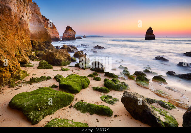 Algarve coast at sunrise near Lagos, Algarve, Portugal - Stock Image
