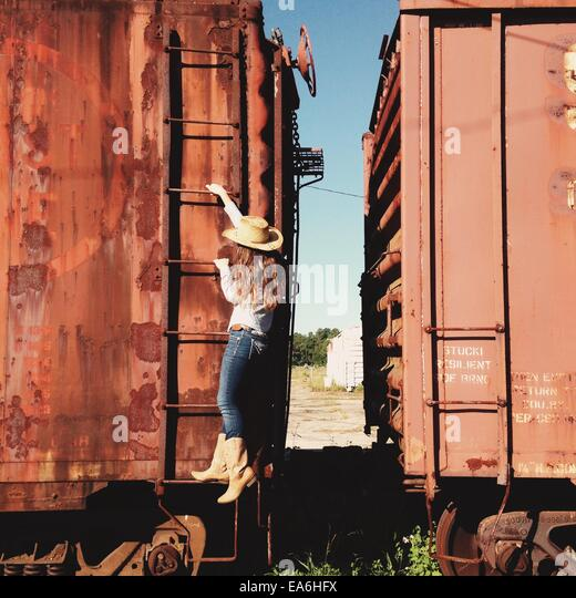 Girl playing on train - Stock Image