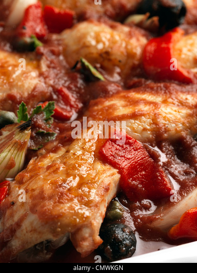 Chicken cacciatore slow cooking Italian casserole - Stock Image