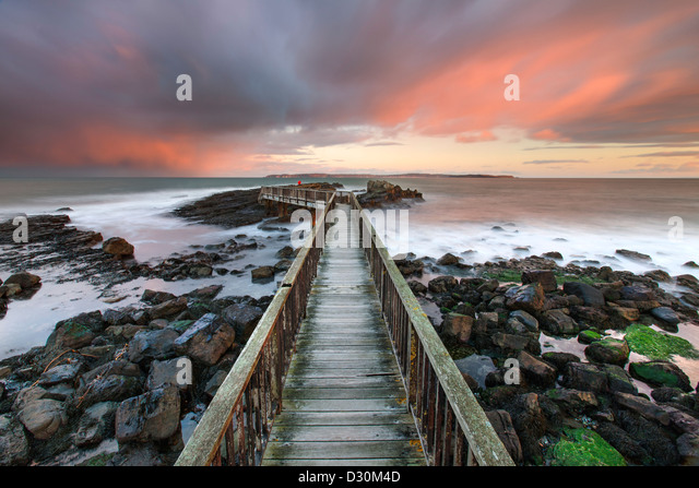 Pans Rocks Jetty, strand beach, Ballycastle. - Stock Image