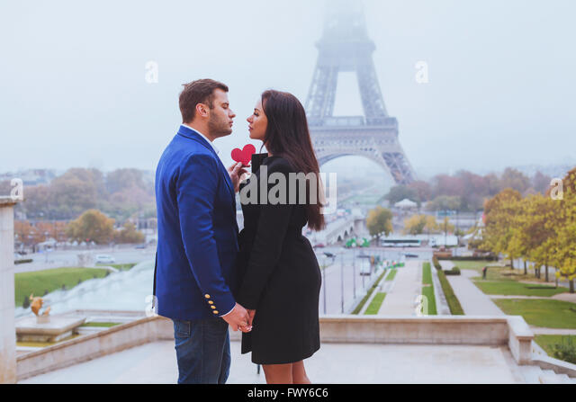 Valentines day travel destination, couple in love near Eiffel Tower, Paris, France - Stock Image