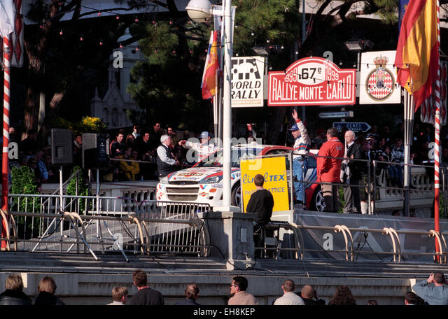 Monte Carlo Rally 1999 Colin McRae and Nicky Grist on the finishing ramp with their Ford Focus WRC - Stock Image