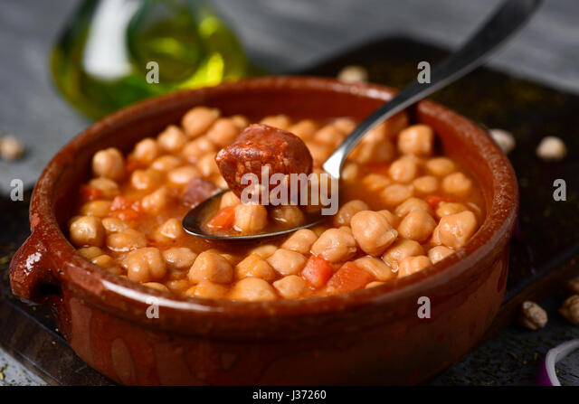closeup of an earthenware bowl with potaje de garbanzos, a spanish chickpeas stew with chorizo and serrano ham, - Stock Image