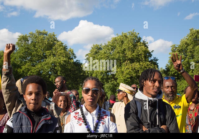 London UK 5th August 2017  People listen to a speaker during  Africa international day of action in Kennington Park - Stock Image