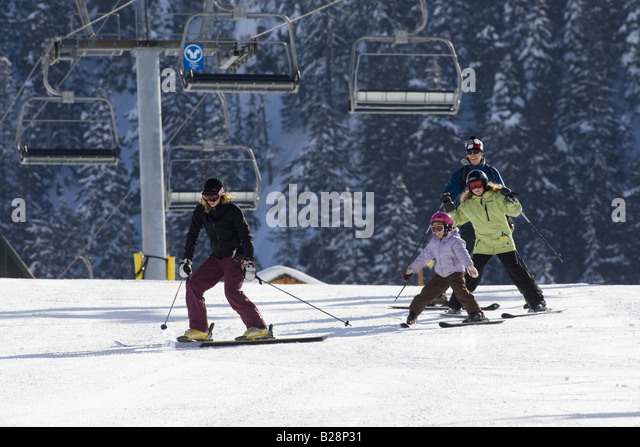 Children larning to ski Whistler British Columbia Canada - Stock Image