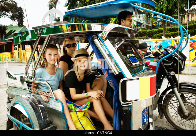 Family riding in alternative transport - Stock Image