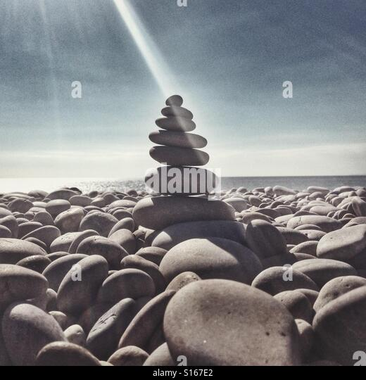 Stack of stones on a beach in the sun - Stock-Bilder