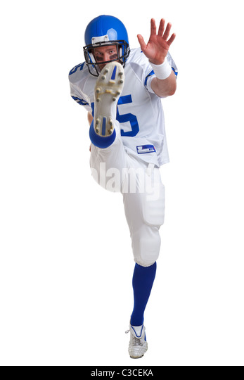 Photo of an American football player kicking, isolated on a white background. - Stock Image