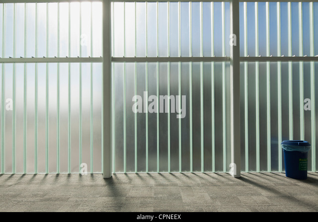 Glass wall in lobby - Stock Image