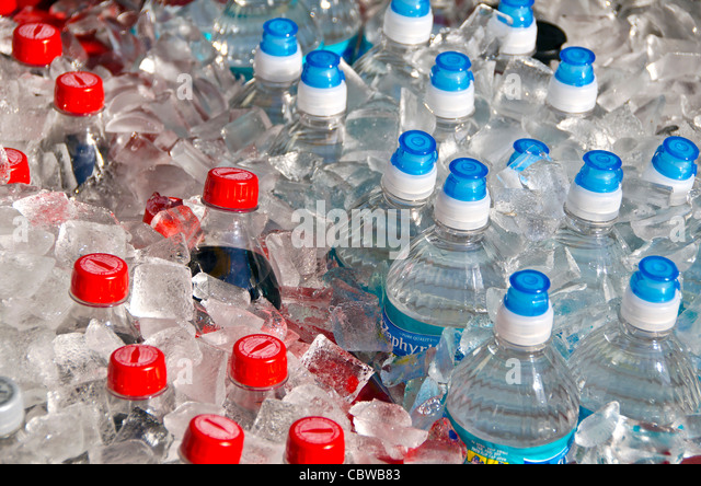 Plastic bottles of water and soda on ice at Universal Studios Orlando Florida - Stock Image