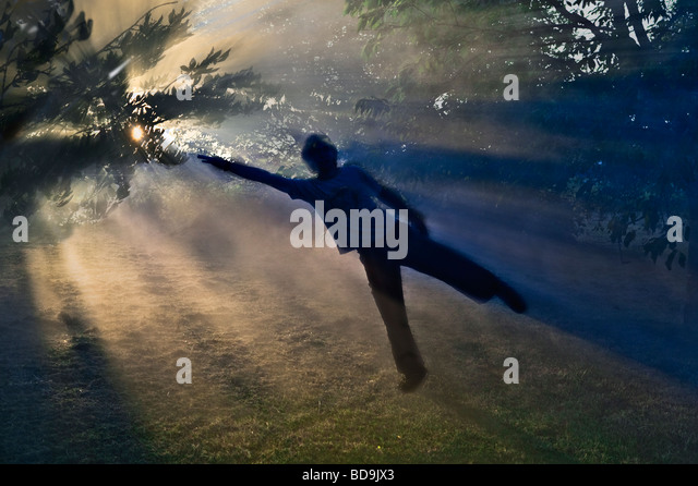 young boy being drawn up by sunlight magnetic field - Stock-Bilder